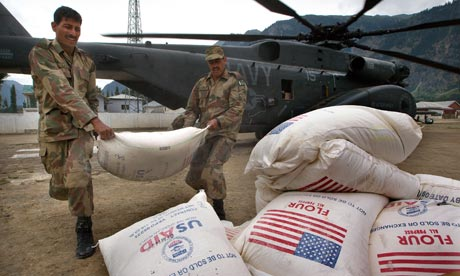 Pakistani soldiers unload food aid from a US Navy helicopter during the 2010 Pakistan Floods relief effort (photo courtesy of  Paula Bronstein/Getty Images).