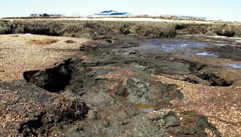 Evidence of the significant, ongoing land erosion that threatens the town of Newtok, Alaska (courtesy of The Guardian).