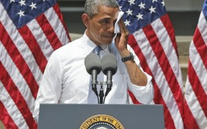 President Obama wipes his brow while delivering his climate speech at Georgetown University on June 25 (courtesy of The Atlantic Wire).