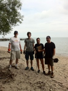 Councilman Matt Zone (far right) and two volunteers flank me from the cleanup effort at Perkins Beach on Saturday, July 6 (courtesy of Drink Local. Drink Tap.).