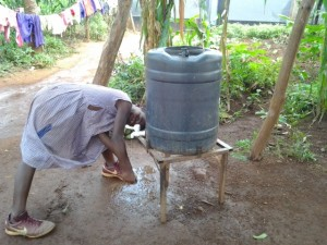 Ugandan child collecting water