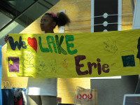 young girl we love lake erie sign