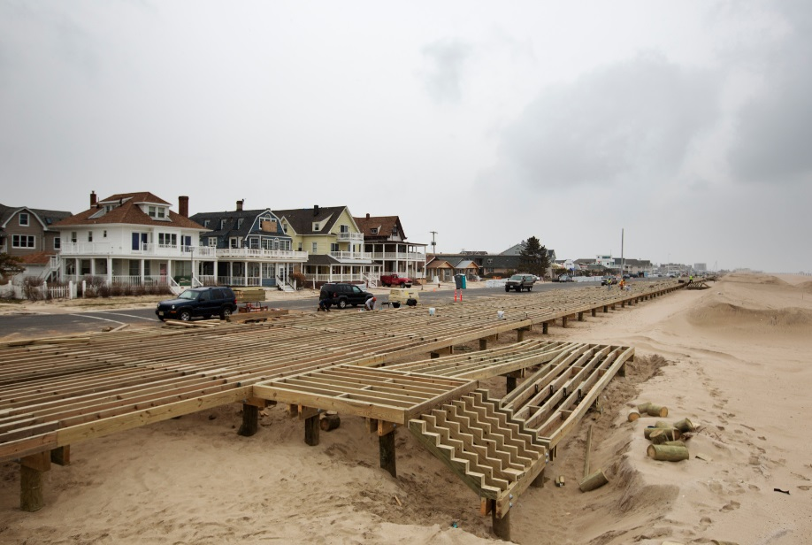 Workers rebuild the boardwalk in Bayhead, New Jersey. The boardwalk was badly damaged by Superstorm Sandy (courtesy of The Atlantic Cities).